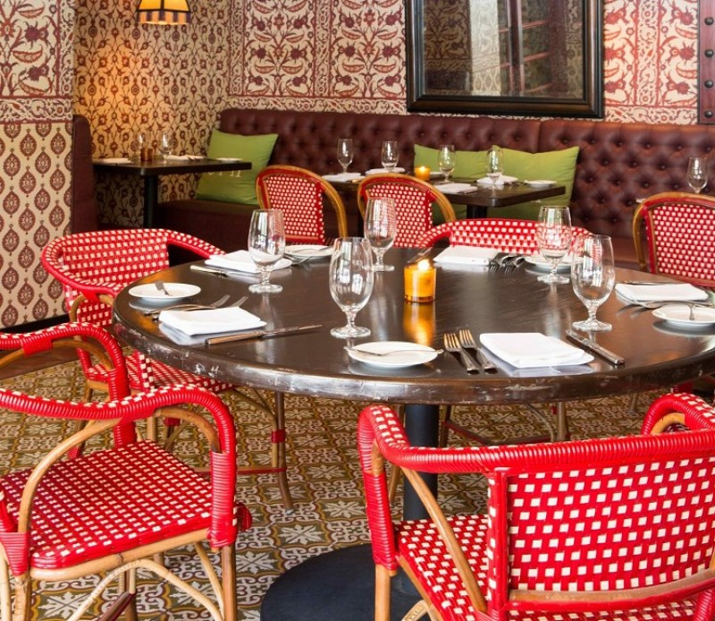 7 Palm Springs Restaurants Where You'll Want to Celebrate Mother's Day palm springs restaurants 7 Palm Springs Restaurants Where You'll Want to Celebrate Mother's Day purple palm springs dining room